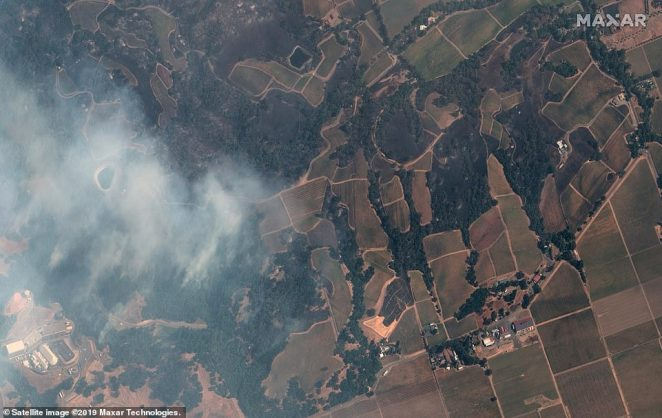 The low humidity and wind in the area has contributed to the fast movement of the fire, as it burned through some 10,000 acers in just a few hours - Some gusts have been reported at up to 70 mph. Pictured is an image captured by theWorldView-3 satellite