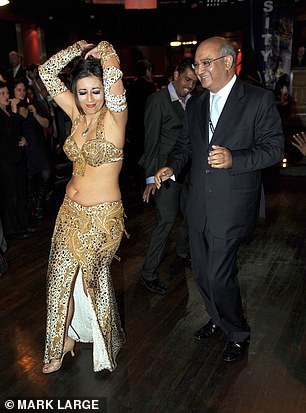 Party animal: Keith Vaz pictured with a belly dancer at the 2009 Labour Conference