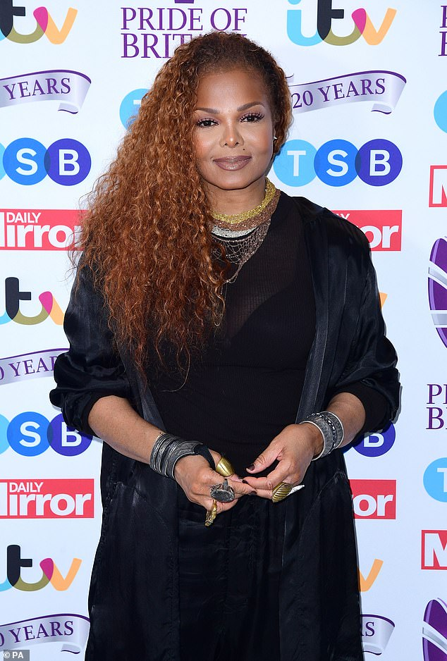 Looking good:The All For You singer, 53, looked chic in a slouchy black top paired with a three-quarter-length coat and joggers as she posed up a storm