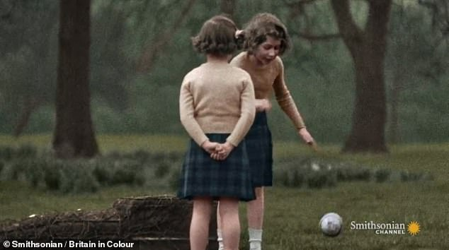 Princess Margaret, then six, and Princess Elizabeth (facing the camera), then ten, play a ball game together at Buckingham Palace in London in 1937