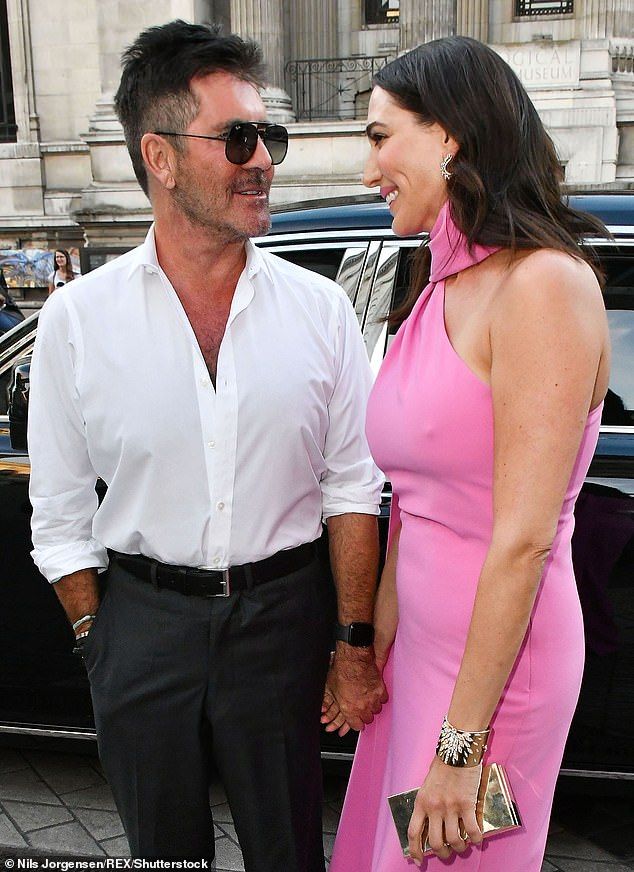 Birthday event: Simon and Lauren sent guests a cancellation on Monday, just two days before the celebration, it read: 'Dear all, I am so sorry but this dinner is cancelled/postponed' (pictured together in July)