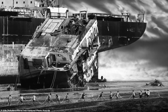 This incredible image, shortlisted in theDocumentary & Photojournalism category, was taken in the 'ship graveyard' in Chittagong, Bangladesh. It shows workers in the process of demolishing a huge container ship. Every year around 200 vessels are taken apart here