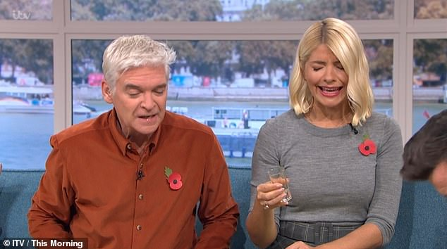 On the booze: Rick Astley got the party going during Wednesday's edition of This Morning when he made Holly Willoughby and Philip Schofield do shots with him