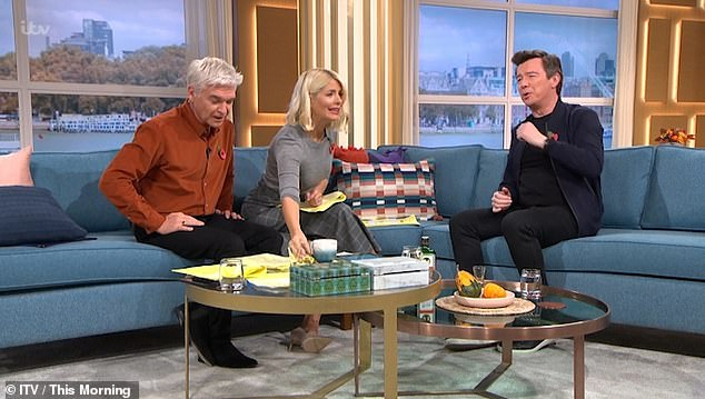 Up for it: The Never Gonna Give You Up hit-maker has a superstition about necking the booze whenever he makes a TV appearance - and Holly and Phil were all too happy to oblige