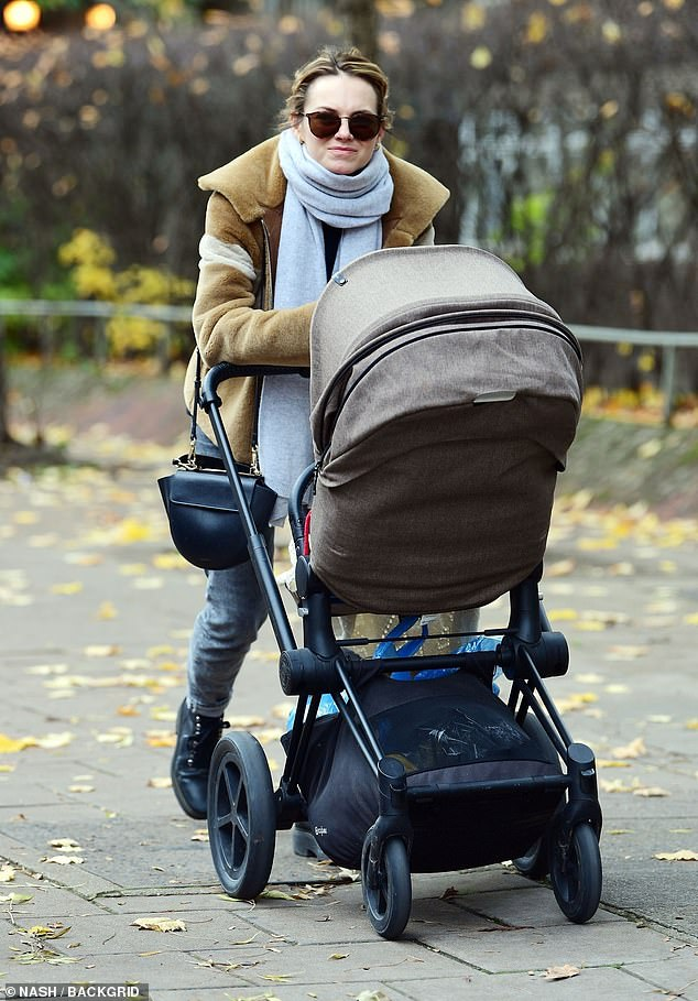 Wrapped up: The actress, 36, cut a chic figure in a tan fluffy jacket teamed with a dove grey scarf as she walked along with a stroller carrying Frey