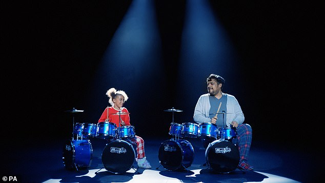 Advert: This isn't Nandi's first brush with fame – last year, she was filmed playing the drums after circling the musical kit in the Argos catalogue, in the Christmas advert