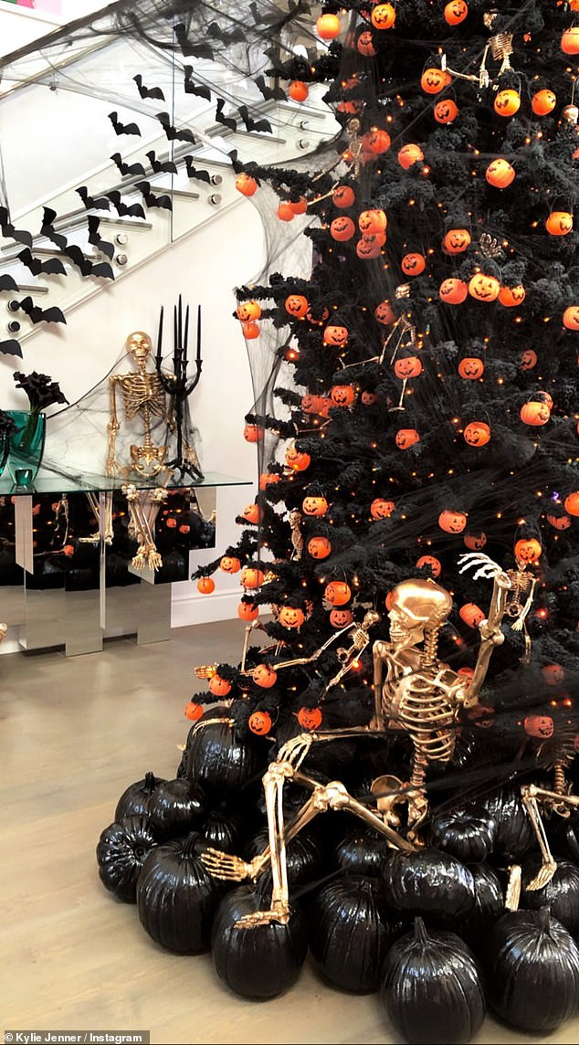 A dark turn: There also were black pumpkins, a large black tree with small orange pumpkin ornaments