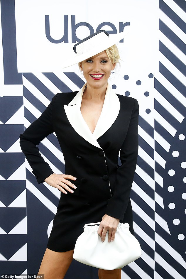 Feeling fresh! The Neighbours actress braved the drizzly weather in a pin-flashing black and white ensemble and matching fascinator
