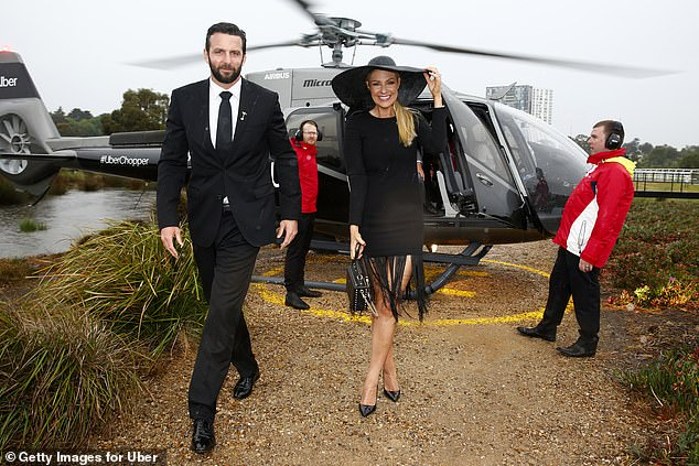 So loved-up!Looking the picture of happiness upon arrival was Yummy Mummies star Lorinska Merrington, who flew in alongside her Carlton player husband Andrew Merrington.