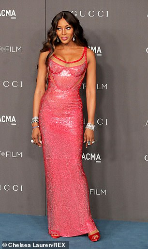 Working it! The catwalk queen, 49, caught the eye as she slipped into a sizzling red gown while posing up a storm on the red carpet