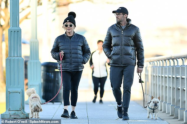 Fashionable!Deborah, 63, looked trendy in her puffer coat, tapered skinny-fit joggers, large bobble hat and designer sunglasses