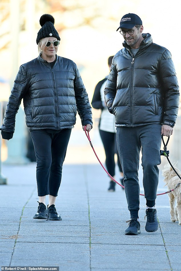 Couples that dress together!Hugh Jackman (right) and wife Deborra-Lee Furness (left) stepped out in matching outfits while walking their dogs in New York on Saturday