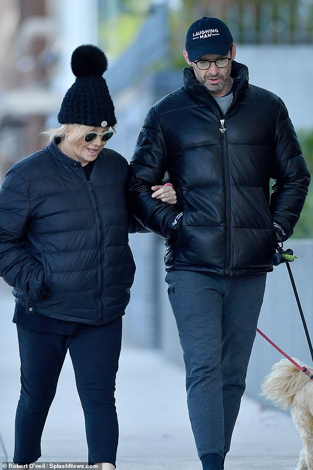 Cold?The loved-up couple, who have been married for 23 years, wrapped up in stylish all-black ensembles as they braved the cold for their leisurely stroll