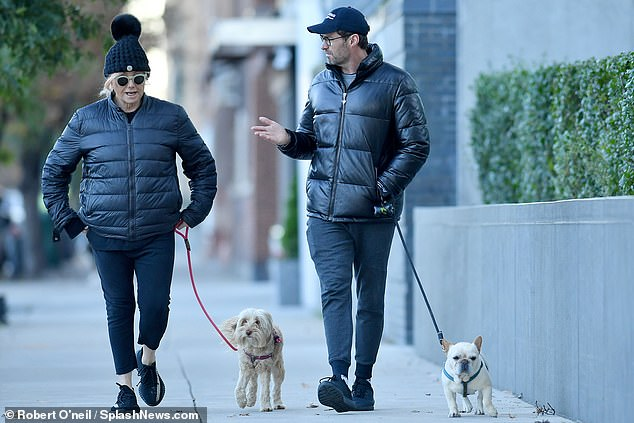 Family walk!The famous couple were joined by their two dogs, caramel coloured poodle-terrier mix Allegra, and French bulldog Dali