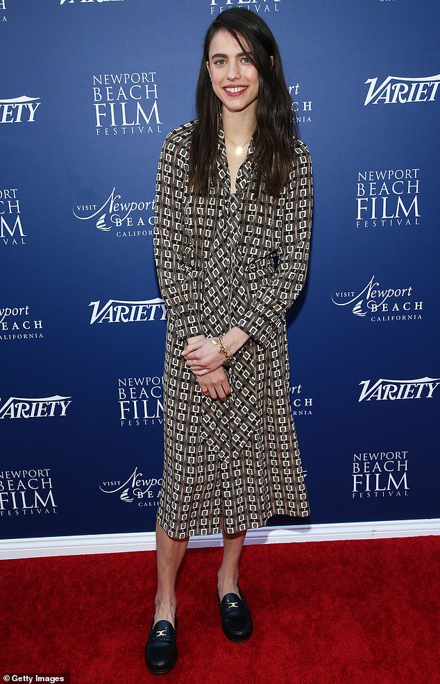 Retro chic: Margaret Qualley went retro chic in a long-sleeve '70s-style dress, featuring a brown geometric print