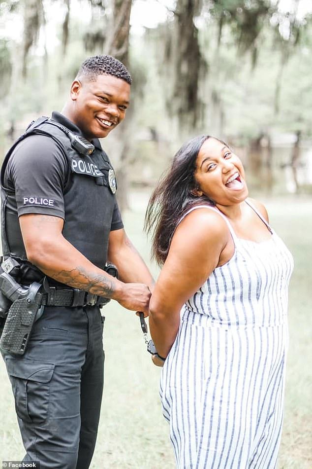 He is seen above playfully 'arresting' his fianceeDallas Michaela Vanderpool