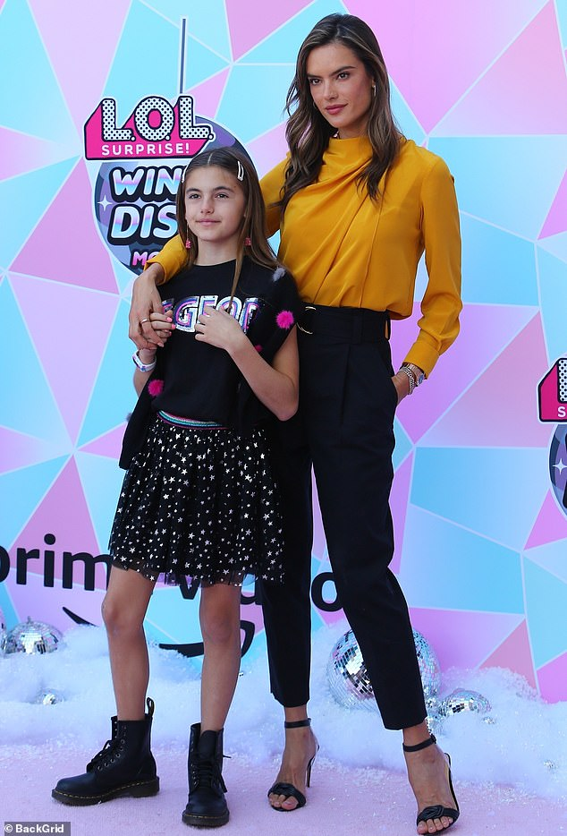 Playing around: Alessandra Ambrosio joined her daughter Anja, 11, at a screening in Los Angeles Sunday of the L.O.L. Surprise! Winter Disco movie, inspired by the popular L.O.L. Surprise! dolls