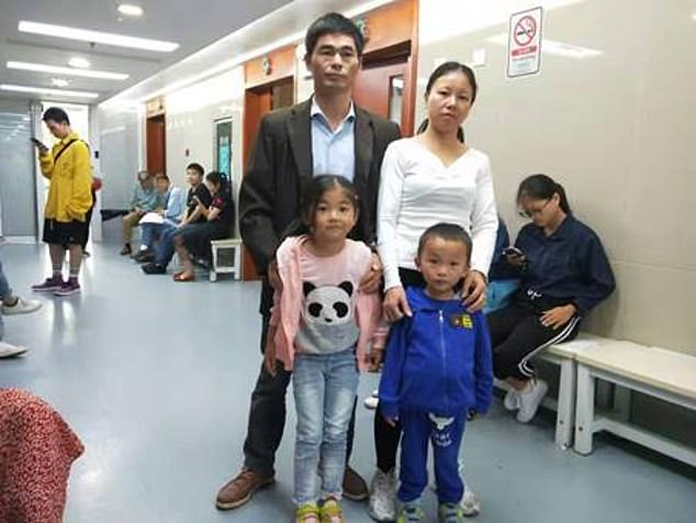 Mr Xiao and his wife Zhan Honghua, 37, are both farmers and impoverished. The couple are pictured with their daughter Qingfeng and sick son Qingle in a Chinese hospital