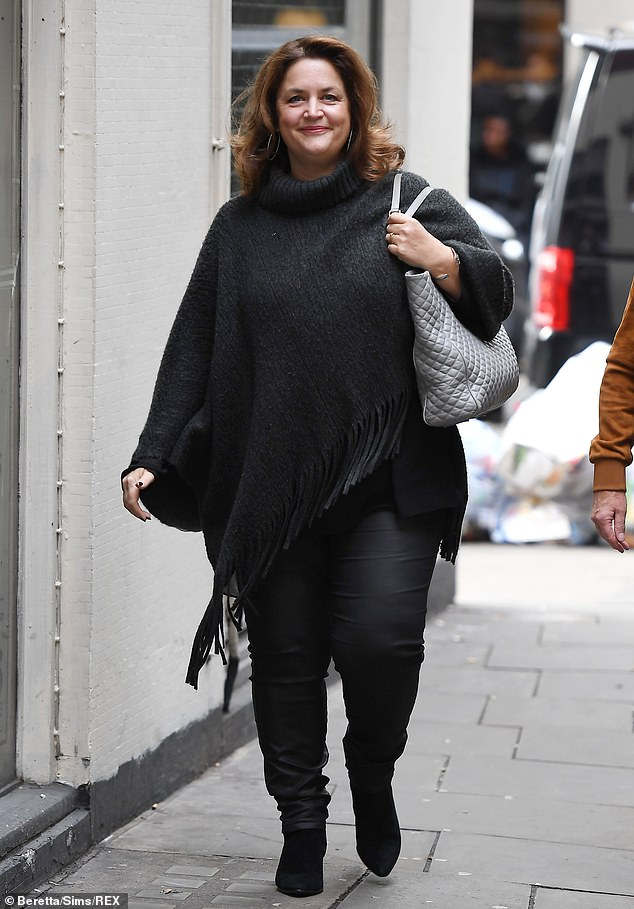 Cheery: Ruth looked chipper as she headed into the Soho Hotel for the media event in a thick winter poncho