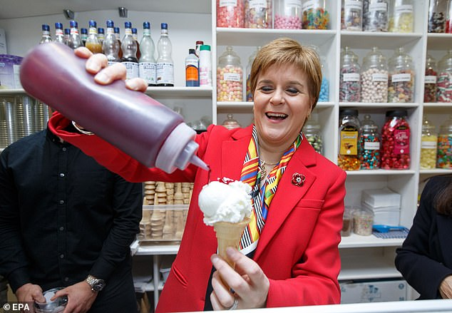 SNP leader Nicola Sturgeon laid down the gauntlet to 'scared' Labour and Tory rivals as she campaigned in Rutherglen today