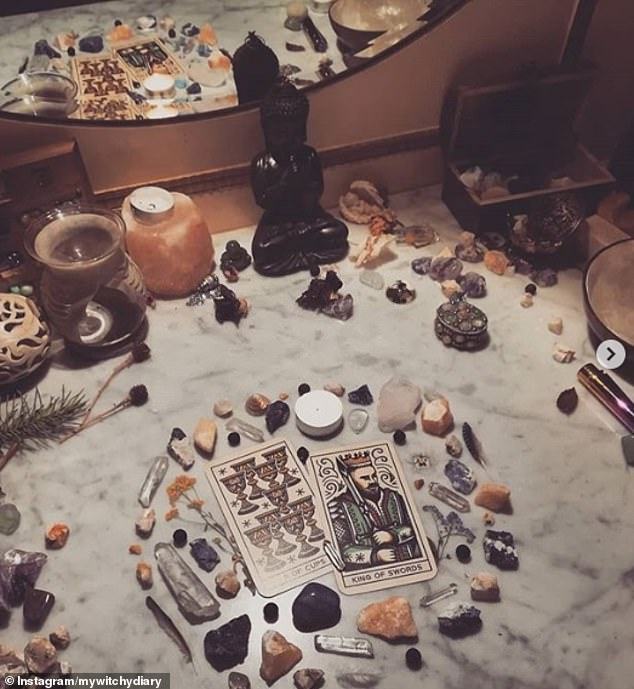 Another witch, whose location is unknown, showed off her 'altar', which includes precious stones, crystals, tarot cards and candles, as well as other belongings