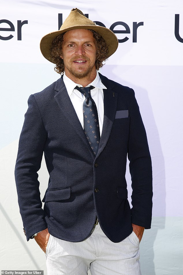 It's not all about the fashionable fillies! Nick 'Honey Badger' Cummins (pictured) and Kris Smith looked dapper in suits as they led the stylish men arriving at the Melbourne Cup in Flemington on Tuesday