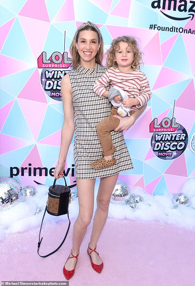 Mom and son date:Whitney Port showcased her incredibly trim frame on Sunday when she stepped out with her son, Sonny, two, for a screening of the L.O.L. Surprise! Winter Disco movie