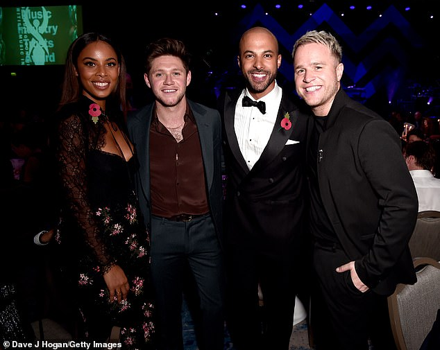 Cosy: Rochelle, Niall, Marvin and Olly got together for a group photograph