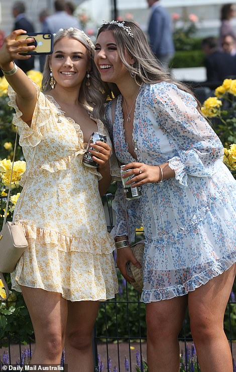 Selfie time! Two young women in summery frocks took pictures