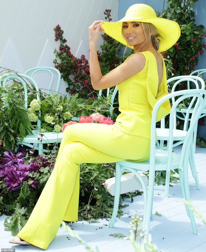 Jimmy who? Nadia Bartel had wore a bold and bright yellow outfit - and looked like she didn't have a care in the world