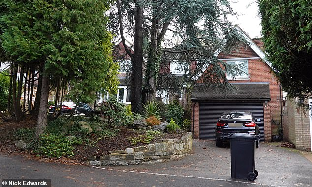 The family lives in this pretty detached home (above) worth £1.3million in the leafy Surrey commuter-belt town of Oxted