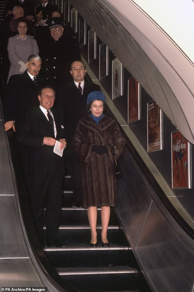 Her majesty was also pictured sporting the same coat when she visited Green Park underground station in 1969