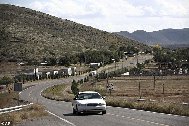 A car passes through Colonia LeBaron. Drug cartel gunmen ambushed three vehicles along a road near the state border of Chihuahua and Sonora, slaughtering at least nine from the extended LeBaron family, all of them U.S. citizens living in northern Mexico, authorities said