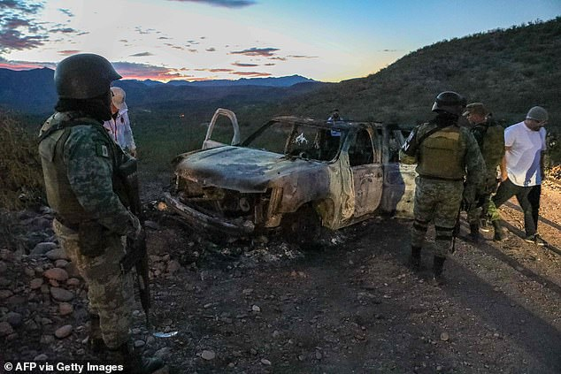 The burned car where some of those murdered were killed during an ambush in Bavispe
