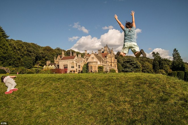 The 2020 handbook will be sent to the National Trust's 5.6million members in time for next year. Pictured: People playing outsideTyntesfield, Somerset in Zsofia Polos's picture
