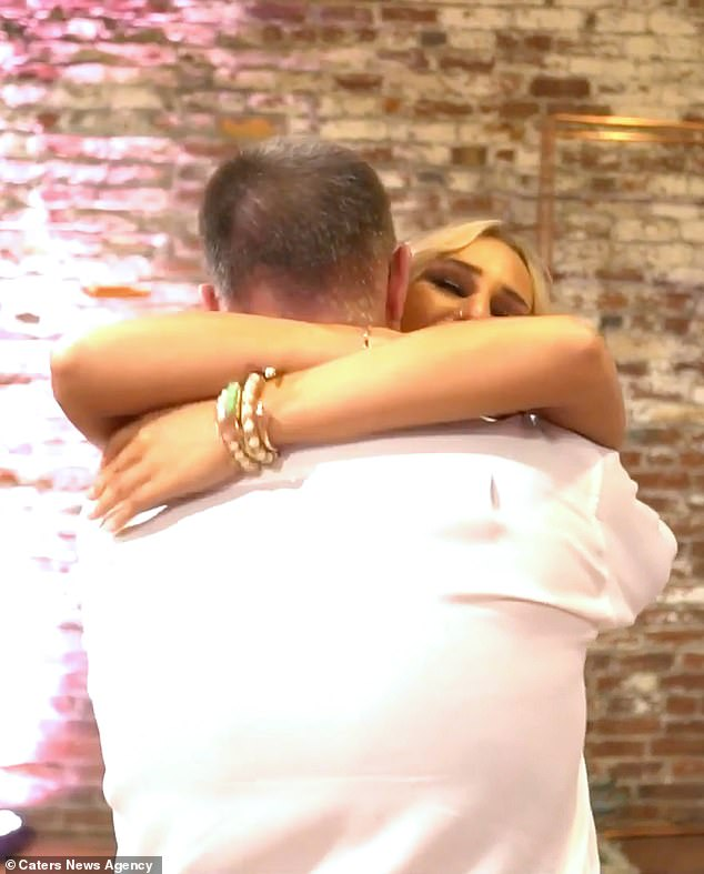 The father and daughter shared a hug after he performed the heartfelt song via sign language