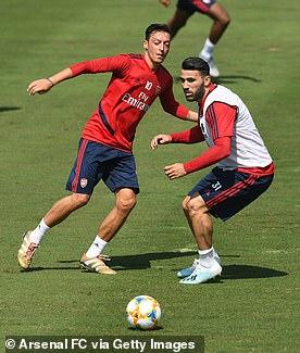 Best friends Mesut Ozil and Sead Kolasinac in a warm up