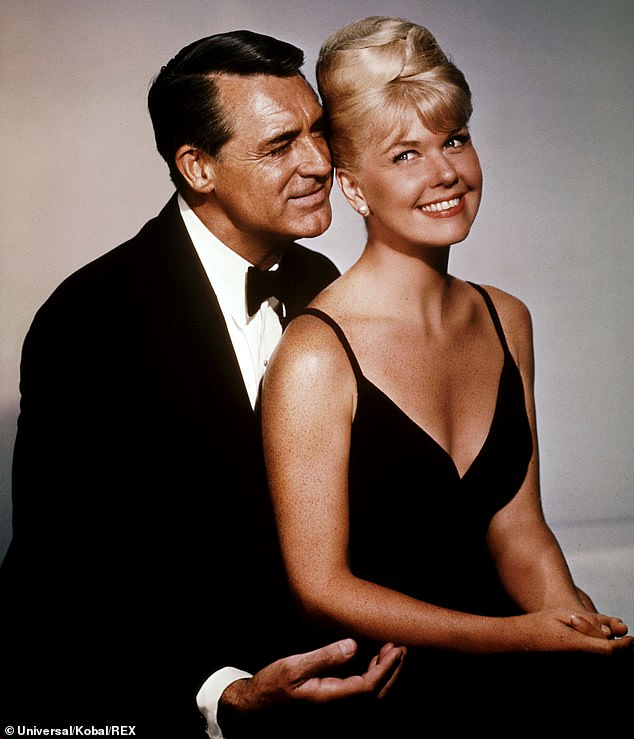 Hollywood legends: Doris starred alongside Cary Grant, pictured, in the hit 1962 flick That Touch of Mink