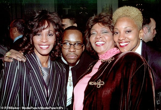 Houston (left) and Crawford (right) are seen with the singer's husband Bobby Brown and another woman at an undated event in New York City