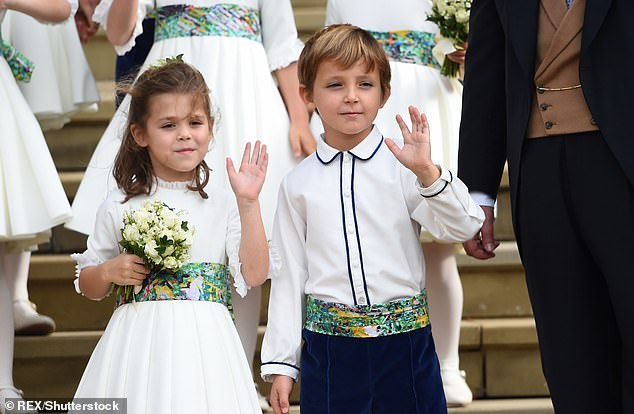 Royal connections: Zoe's son Louis served as a page boy at Eugenie and Jack's wedding in October last year. Pictured, with friend Theodora Williams, daughter of Robbie and Ayda