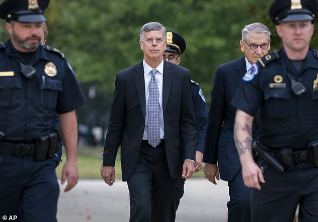 Ambassador William Taylor was escorted by U.S. Capitol Police to his deposition on October 22; he said he had a 'clear understanging,' based on secondhand conversations, that the U.S. was withholding military aid to Ukraine in order to push the country toward a corruption investigation of Joe Biden and his son Hunter Biden