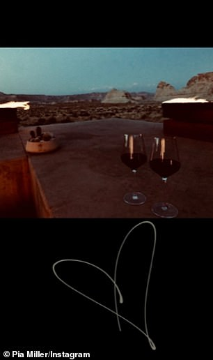 She posted a romantic snap of two wine glasses