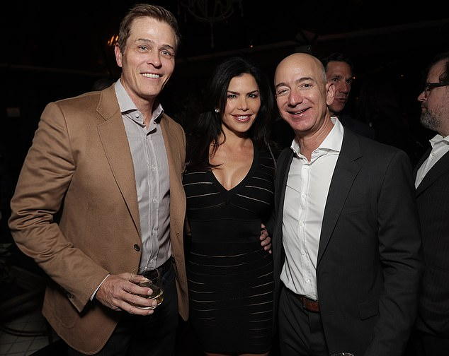 Whitesell and his now-ex pose with Bezos at Matt Damon's Manchester By The Sea Holiday Party on December 3, 2016 in Los Angeles