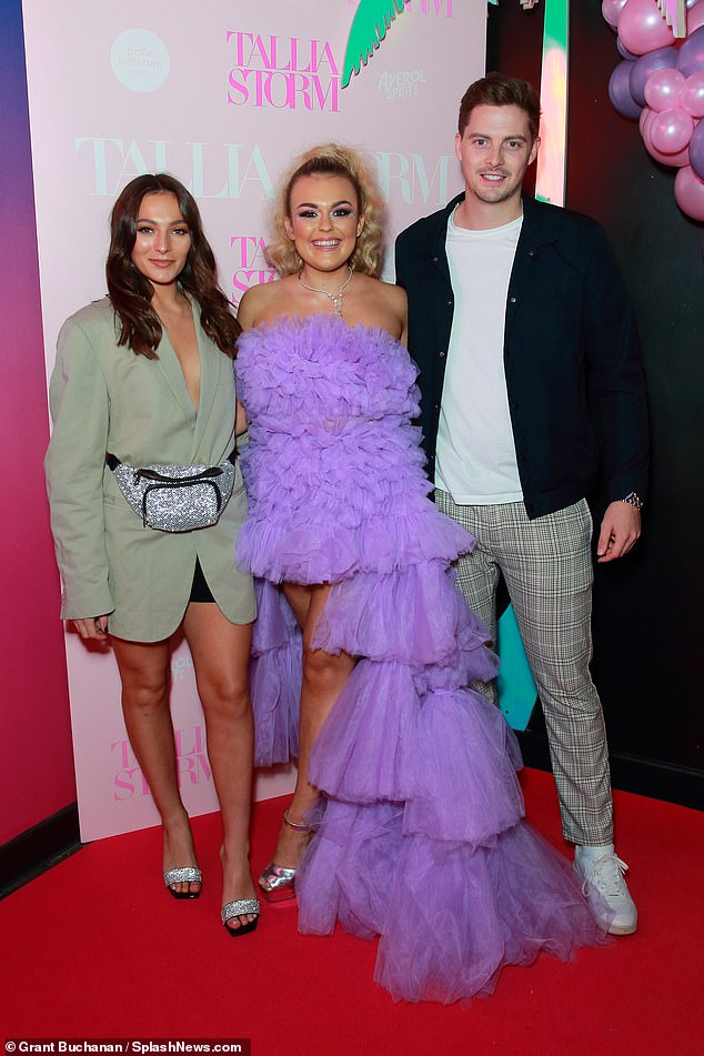 Show of support: Love Island'sAlex George was accompanied by his girlfriend Amelia