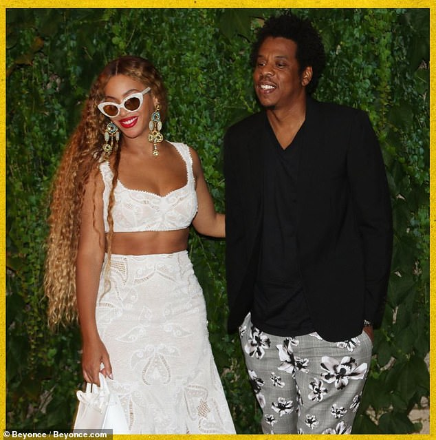 Alwasy by his side: His wife Beyonce is seen here with the musician over the summer