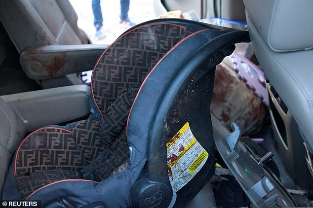 Police found a baby car seat spattered with blood in a bullet-riddled SUV that was being driven by one of the mothers