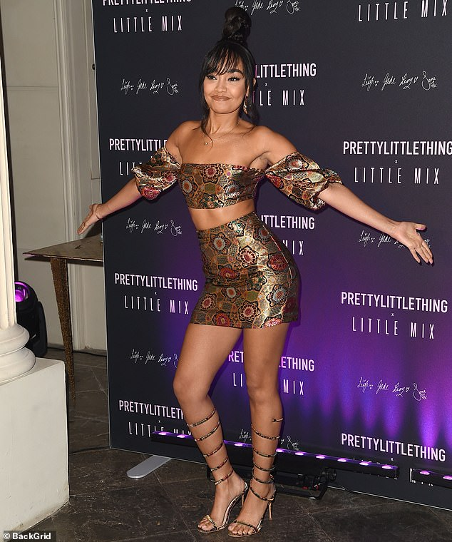 Statement: Leigh-Anne teamed her tiny two-piece with a pair of very strappy heeled shoes