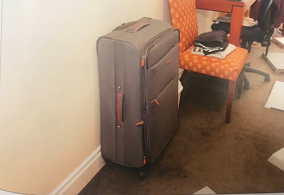 The images, tendered in court, show clothes strewn over the ruffled bedsheets and a suitcase (pictured) in the corner which is not the one the alleged killed used to dump her body