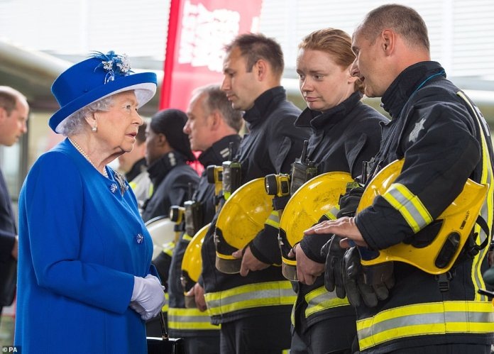 Queen Elizabeth II meets firefighters during her visit to the Westway Sports Centre in West London in June 2017