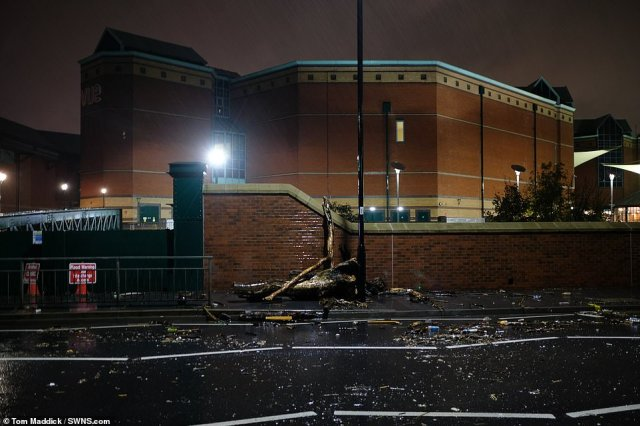 The Meadowhall shopping centre in Sheffield is pictured overnight next to the River Don which is close to bursting its banks